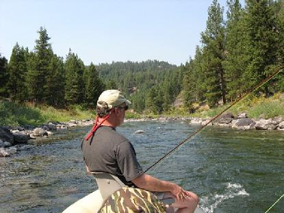 Clarke looks at home, fishin' on the Blackfoot River in Montana.