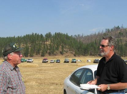 Forest Hayes explains to Clarke how they fight fires in the West.